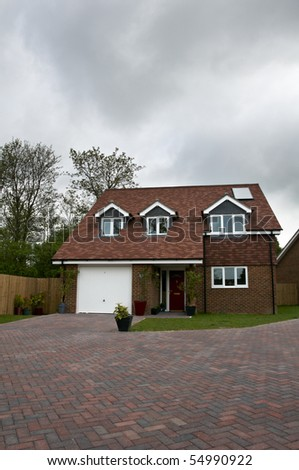 A detatched house with anovercast sky - stock photo