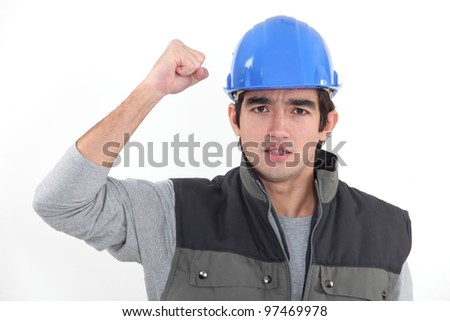 A determined man rejoicing - stock photo