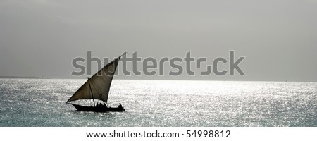 A dhow boat sailing on the coast of africa