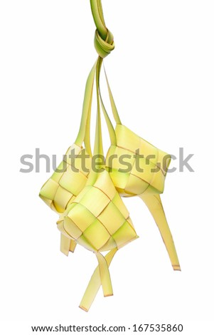 A diamond shaped traditional packed rice made from woven leaf. Ketupat or rice dumpling is a local delicacy during the festive season. - stock photo
