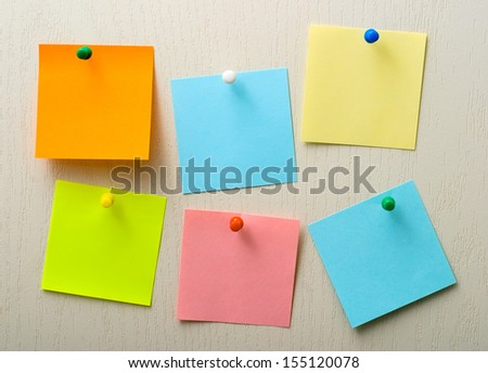 A different color post it notes and pins - stock photo