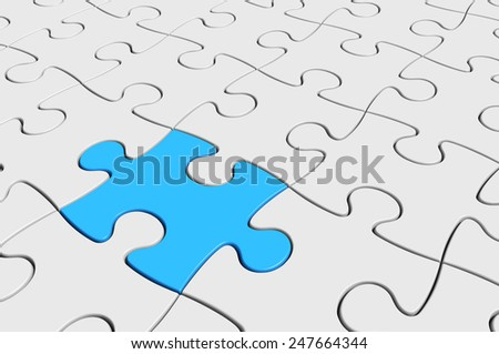A different puzzle piece, standing out from the crowd - stock photo