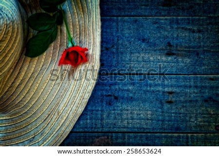 A digitally constructed painting of a ladies sunhat with a red rose - stock photo