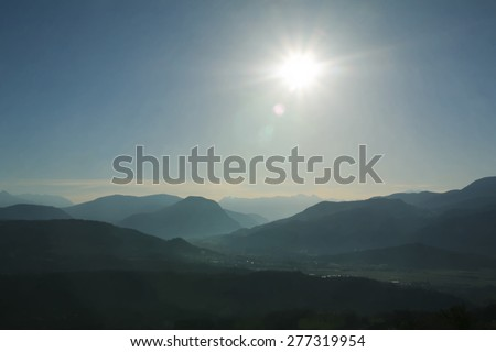 A digitally constructed painting of the sun rising above the mountains surrounding Tallard, Haute Alpes, Franc - stock photo