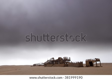 A dilapidated oil rig sits on the Skeleton Coast of Namiba. - stock photo