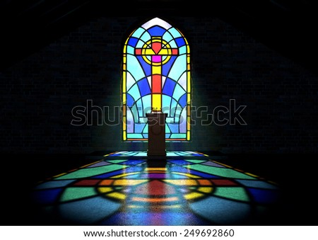 A dim old church interior lit by suns rays penetrating through a colourful stained glass window in the pattern of a crucifix reflecting colours on the floor and a speech pulpit - stock photo