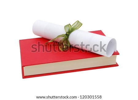 A diploma over red book Isolated on white. - stock photo