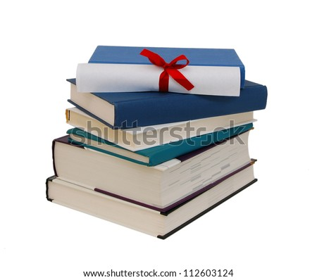 A diploma with red ribbon over blue books. Isolated on white. - stock photo