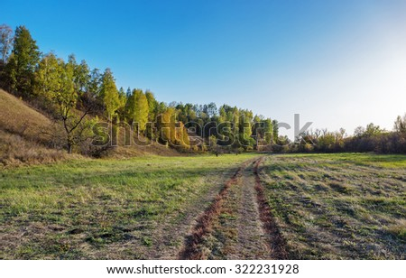 A dirt road in countryside - stock photo