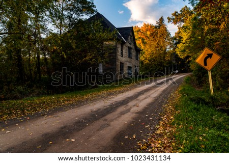 A dirt road near Watkins Glen in the Finger Lakes of New York leads to a long disused clapboard sided fruit packing house.
