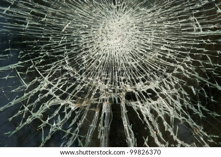 A dirty broken window pane in black and white - stock photo