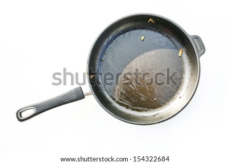 A dirty pan isolated on white. - stock photo