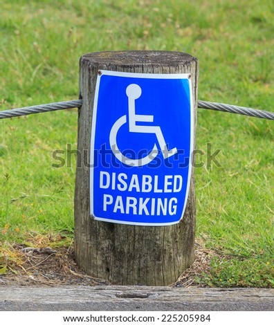 A disabled (handicap) parking only sign on the street side, for providing close access door. - stock photo