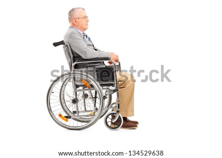 A disabled senior gentleman posing in a wheelchair isolated on white background - stock photo