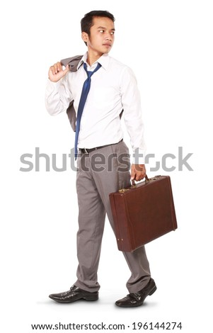 a disappointed businessman walking with bags and rear-facing isolated on white background - stock photo