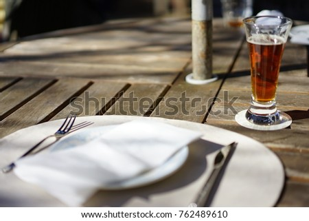 https://thumb1.shutterstock.com/display_pic_with_logo/167494286/762489610/stock-photo-a-dish-knife-and-fork-before-meals-762489610.jpg