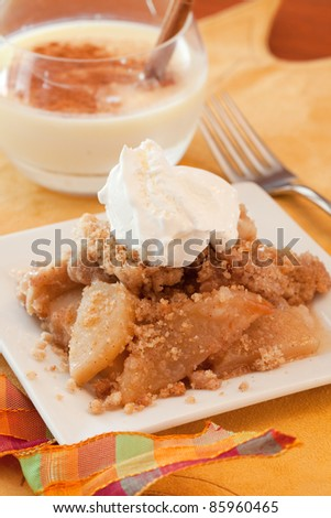 A Dish Of Apple Crisp with Whipped Cream Topping and Eggnog