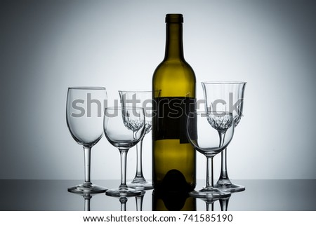 A display of empty wine glasses and a wine bottle.