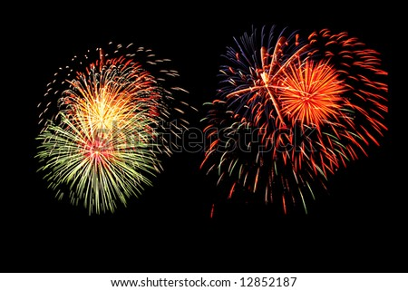 A display of fireworks against a black sky on the 4th of July. - stock photo