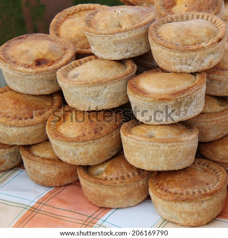 A Display of Freshly Made Pork Pies. - stock photo