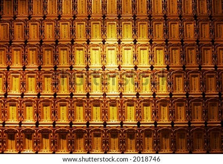A display on the wall of a Buddhist temple. - stock photo