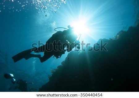 A diver moving foward - stock photo