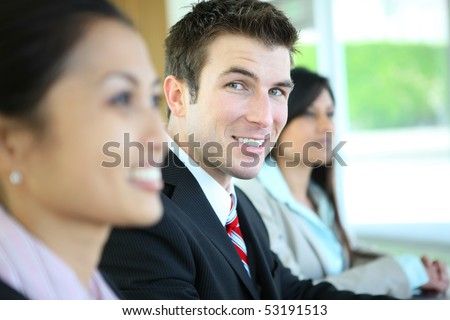 A diverse attractive man and woman business team at meeting