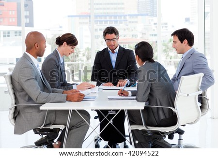 A diverse business group disscussing a budget plan in a meeting - stock photo
