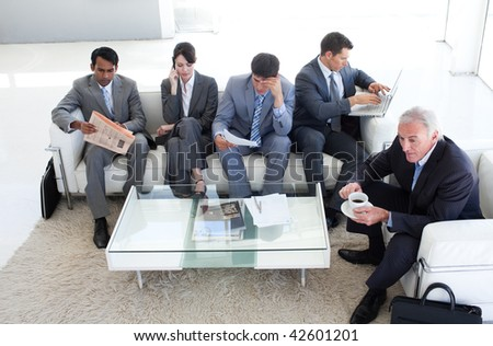 A diverse business people sitting in a waiting room. Business concept. - stock photo