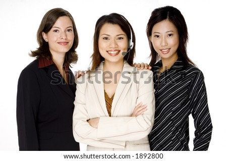 A diverse business team standing in a group on white background