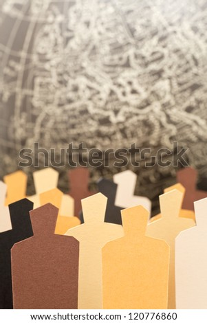 A diverse group with the Earth on the background. Focus on the yellow figure - stock photo