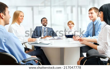 A diverse work group working together.  - stock photo