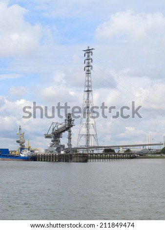 A dockside crane along the river Thames / crane and tower