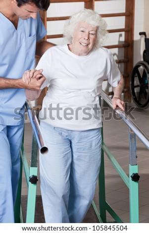 A doctor assisting a senior citizen . - stock photo