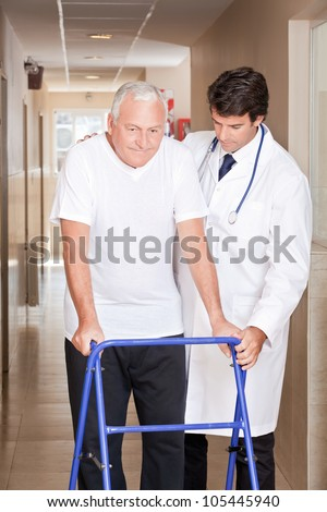 A doctor assisting a senior citizen onto his walker.