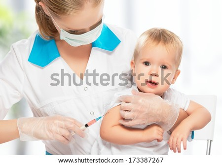 A doctor does injection child vaccination baby