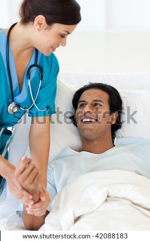 A doctor examining a patient lying on a hospital bed. Medical concept. - stock photo