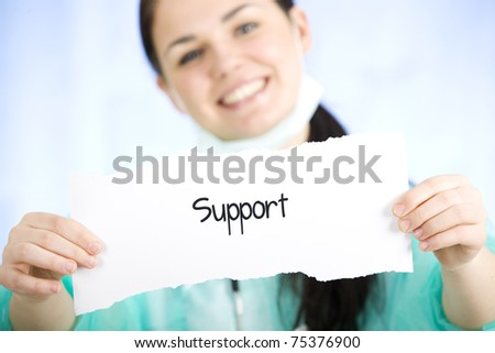 A doctor holding a paper sign