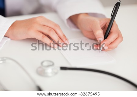 A doctor is writing a note