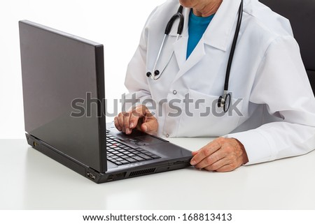 A doctor on duty working on a laptop