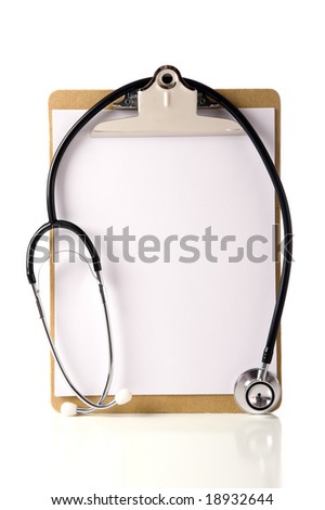 A doctor or nurses clipboard with a stethoscope and  and a blank sheet of notebook paper for information or copy space.  Health care of health concept