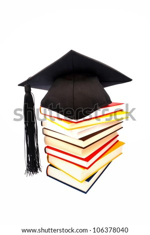 a doctor's book on a pile on white background. symbol for costs in training and education - stock photo