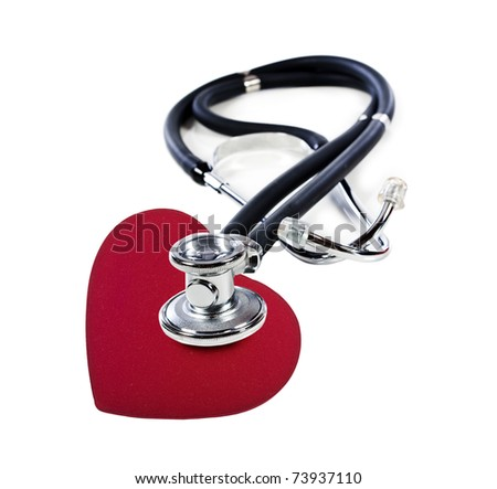 a Doctor's stethoscope listening to a red heart  on a white background with space for text - stock photo