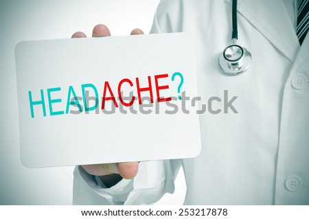 a doctor showing a signboard with the question headache? written in it - stock photo
