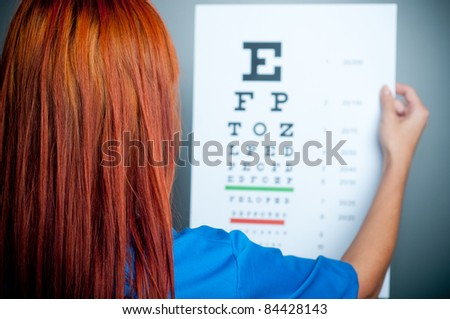 a doctor watching a test for eye examination