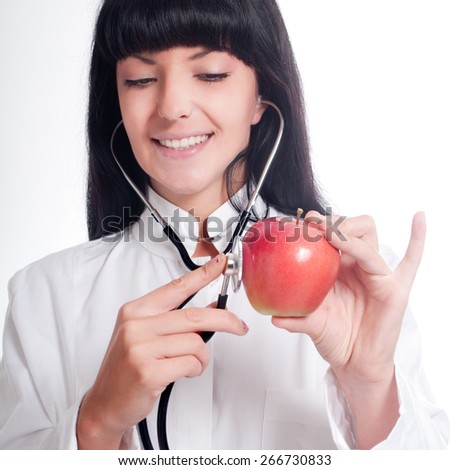 A doctor with stethoscope and apple