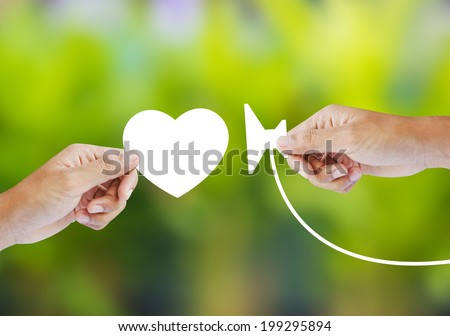 A doctor with stethoscope holding heart - stock photo