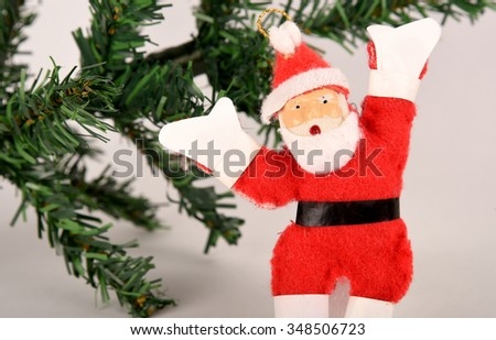 a doll of Santa Claus on a white background