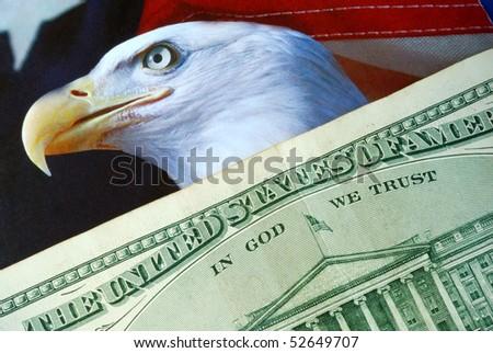 A dollar bill on the American Eagle flag - stock photo