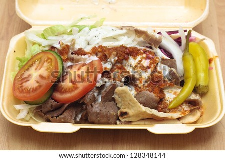 A doner kebab in styrofoam container - stock photo